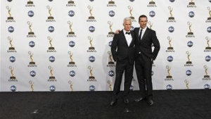 "Actors John Slattery (L) and Jon Hamm, from ""Mad Men"" pose after the series won the award for outstanding drama series at the 60th annual Primetime Emmy Awards in Los Angeles, September 21, 2008. REUTERS/Mike Blake"