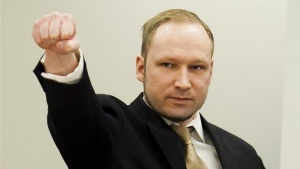 Norwegian mass killer Anders Behring Breivik gestures as he arrives for his terrorism and murder trial in a courtroom in Oslo April 16, 2012. Breivik, who massacred 77 people last summer, arrived under heavy armed guard at an Oslo courthouse on Monday, lifting his arm in what he has called a rightist salute as his trial began. Breivik, 33, has admitted setting off a car bomb that killed eight people at government headquarters in Oslo last July, then massacring 69 in a shooting spree at an island summer camp for Labour Party youths. REUTERS/Heiko Junge/Pool