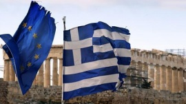 The Parthenon on the Athens Acropolis is seen behind a Greek and an EU flag atop the Greek ministry of finance on February 8, 2012. REUTERS/Yannis Behrakis