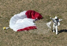 Pilot Felix Baumgartner of Austria celebrates after successfully completing the final manned flight for Red Bull Stratos in Roswell, New Mexico in this October 14, 2012 handout photo. REUTERS/Predrag Vuckovic/Red Bull/Handout