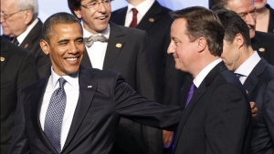 U.S. President Barack Obama (L) leads British Prime Minister Cameron from a family photo at the NATO Summit in Chicago, May 20, 2012. REUTERS/Andrew Winning