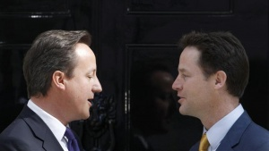 Britain's Prime Minister David Cameron (L) chats with Deputy Prime Minister Nick Clegg outside 10 Downing Street in London May 12, 2010. REUTERS/Suzanne Plunkett