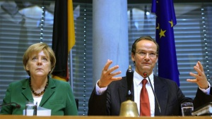 German Chancellor Angela Merkel attends a session of the EU committee of the German lower house of parliament, the Bundestag, headed by Gunther Krichbaum (R) in Berlin, September 29, 2010. REUTERS/Thomas Peter