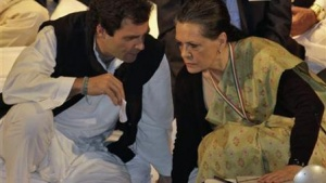 Rahul Gandhi speaks to Sonia Gandhi (R) during the Indian National Congress meeting in Jaipur, January 20, 2013. REUTERS/Stringer 