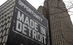 A large &quot;Opportunity Made In Detroit&quot; banner is seen on the side of one of the buildings owned by Quicken Loans founder Dan Gilbert in downtown Detroit, Michigan, January 30, 2013. REUTERS/Rebecca Cook
