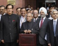 Finance Minister Pranab Mukherjee (2nd L) poses as he leaves his office to present the 2012/13 budget in New Delhi March 16, 2012. REUTERS/Vijay Mathur/Files