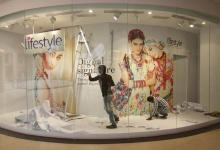 Labourers change the display of a Lifestyle departmental store at Phoenix market city in Mumbai February 26, 2013. REUTERS/Vivek Prakash