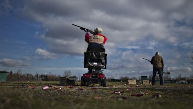 A member of the Vancouver Gun Club takes aim while trap shooting at their facility in Richmond, British Columbia February 10, 2013. Formed in 1924 the shotgun only club hosts up 1000 shooters a year including several national inter nation competitions.  REUTERS/Andy Clark    (CANADA)