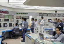 Workers of Kansai Electric Power's Ohi nuclear power plant monitor the restart of the No.3 unit in Ohi, Fukui prefecture, in this file photo taken by Kyodo, July 1, 2012. REUTERS/Kyodo/Files