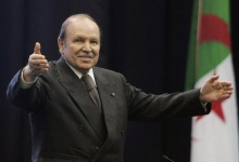 Algeria's President Abdelaziz Bouteflika waves during a speech to commemorate the 38th anniversary of the nationalization of hydrocarbon resources in Oran February 24, 2009. REUTERS/Louafi Larbi 