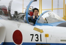 Japan's Prime Minister Shinzo Abe poses inside the cockpit of a T-4 training jet plane of the Japan Air Self-Defense Force's (JASDF) Blue Impulse flight team at the JASDF base in Higashimatsushima, Miyagi prefecture May 12, 2013. REUTERS/Kyodo