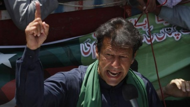 Imran Khan, Pakistani cricketer-turned-politician and chairman of political party Pakistan Tehreek-e-Insaf (PTI), addresses his supporters after his visit to mausoleum of Mohammad Ali Jinnah, founder and first governor-general of Pakistan, during an election campaign in Karachi May 7, 2013. REUTERS/Athar Hussain