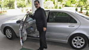 Sahara Group Chairman Subrata Roy poses for a photograph after an interview with Reuters outside his company's office in Lucknow May 6, 2013. REUTERS/Pawan Kumar