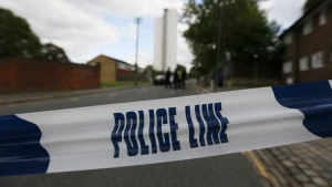 Police tape marks a cordon set up around a crime scene where one man was killed in Woolwich, southeast London May 22, 2013. REUTERS/Stefan Wermuth