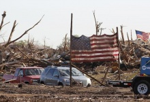 A U.S. flag from the Plaza Towers elementary school is erected on poles in front of the school in Moore, Oklahoma, May 22, 2013. REUTERS/Rick Wilking