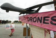 Demonstrators stand beside a mock drone outside the gates of Fort McNair where President Barack Obama will speak at Washington's National Defense University May 23, 2013. REUTERS/Kevin Lamarque