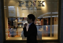 A man walks by the Thomas Pink store on Wall St. in New York, March 18, 2013. REUTERS/Brendan McDermid