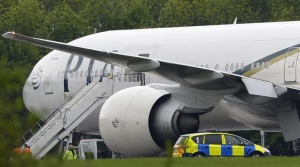 A Pakistan International Airlines Boeing 777 aircraft is seen parked on the tarmac at Stansted Airport, southern England, May 24, 2013. REUTERS/ Paul Hackett