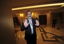 Former leader of the Syrian National Coalition (SNC) Moaz Alkhatib reacts as he arrives for a meeting in Istanbul May 23, 2013. REUTERS/Bulent Kilic/Pool