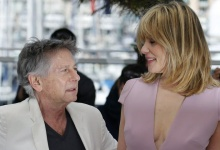 "Director Roman Polanski (L) poses with his wife and cast member Emmanuelle Seigner during a photocall for the film ""La Venus a la Fourrure""; (Venus in Fur) at the 66th Cannes Film Festival in Cannes May 25, 2013. REUTERS/Regis Duvignau"