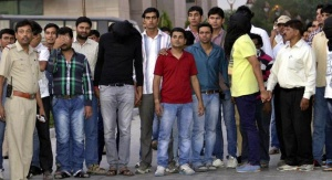 Police escort bookies and cricket players after they were produced in a court in New Delhi May 16, 2013. REUTERS/Stringer