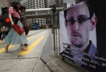 A poster supporting Edward Snowden, a former contractor at the National Security Agency (NSA) who leaked revelations of U.S. electronic surveillance, is displayed at Hong Kong's financial Central district June 17, 2013. REUTERS/Bobby Yip