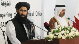 Muhammad Naeem (L), a spokesman for the Office of the Taliban of Afghanistan speaks during the opening of the Taliban Afghanistan Political Office in Doha June 18, 2013.  REUTERS/Mohammed Dabbous