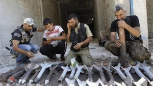 Members of the Ghurabaa al-sham brigade prepare homemade missiles at Aleppo's district of al Sakhour June 15, 2013. REUTERS/Muzaffar Salman