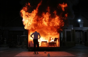 A controlled burn demonstration in a constructed room blazes away, setting a mannequin standing in front of it on fire, during a media open house at the Alcohol, Tobacco and Firearms (ATF) National Laboratory Center in Beltsville, Maryland June 18, 2013.    REUTERS/Gary Cameron
