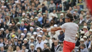 Rafael Nadal of Spain hits a return to compatriot David Ferrer during their men's singles final match at the French Open tennis tournament at the Roland Garros stadium in Paris June 9, 2013. REUTERS/Stephane Mahe