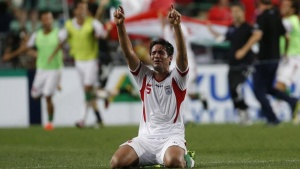Iran's Amir Hossein Sadeghi celebrates after defeating South Korea in their World Cup qualifying soccer match in Ulsan, southeast of Seoul June 18, 2013.   REUTERS/Kim Hong-Ji