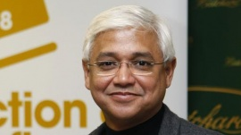 Amitav Ghosh poses in central London October 14, 2008. REUTERS/Stephen Hird/Files