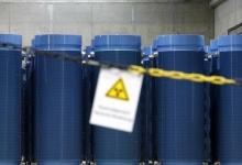 A warning sign for radioactive materials is seen in the warehouse for so-called 'Castor' containers, filled with highly radioactive spent nuclear fuel, in the temporary nuclear waste storage facility in the northern German village of Gorleben near Dannenberg June 20, 2006. REUTERS/ Christian Charisius/Files
