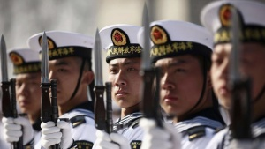 New recruits of the Chinese Navy fleet stand with their guns during the parade marking the end of their first training session in Qingdao, Shandong province, March 4, 2013. REUTERS/Stringer