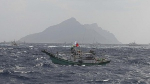 A Taiwanese fishing boat sails near the disputed East China Sea islets called Senkaku in Japan, Diaoyutai in China and Tiaoyutai in Taiwan in this handout photo from Central News Agency September 25, 2012.  REUTERS/Central News Agency/Handout