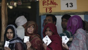 Voters queue inside a polling station to cast their vote during the state assembly election in New Delhi December 4, 2013. REUTERS/Adnan Abidi
