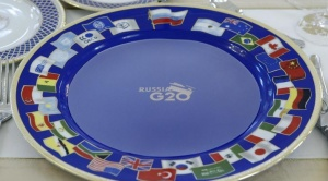 A dish with the logo of the G20 Summit is pictured in the banquet room for the attendees of the G20 Summit in Constantine Palace in Strelna near St. Petersburg, September 5, 2013. REUTERS/Sergei Karpukhin/Files