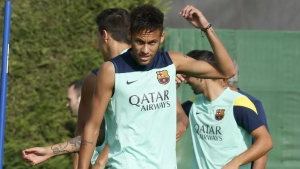 FC Barcelona's player Neymar takes part during the training session at Ciutat Esportiva Joan Gamper in Sant Joan Despi near Barcelona, October 18, 2013.  REUTERS/Gustau Nacarino/Files