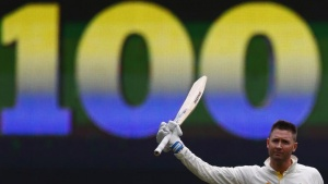 Australia's captain Michael Clarke celebrates his century during the second day of the second Ashes test cricket match against England at the Adelaide Oval December 6, 2013. REUTERS/David Gray