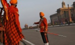 "A member of the military band directs his comrades before the start of the rehearsal for the ""Beating the Retreat"" ceremony in New Delhi January 27, 2014. REUTERS/Ahmad Masood"