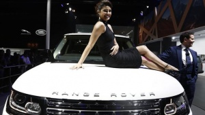 Bollywood actress Priyanka Chopra poses with Jaguar Land Rover's Range Rover LWB during its launch at the Auto Expo in Greater Noida, on the outskirts of New Delhi February 5, 2014. REUTERS/Adnan Abidi