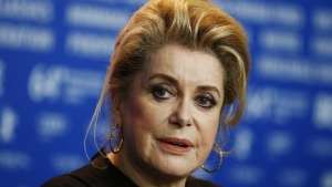 "Cast member Catherine Deneuve attends a news conference to promote the movie ""Dans La Cour (In the Courtyard)"" at the 64th Berlinale International Film Festival in Berlin February 11, 2014. REUTERS/Thomas Peter/Files"