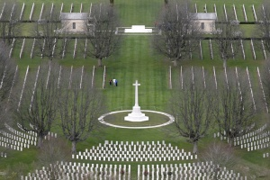 An aerial view shows people walking among tombstones as they visit the Commonwealth War cemetery in Bayeux in the Normandy region, March 29, 2014. REUTERS/Christian Hartmann