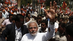 Hindu nationalist Narendra Modi, prime ministerial candidate for Bharatiya Janata Party (BJP), waves to his supporters as he arrives to file his nomination papers for the general elections in Varanasi April 24, 2014. REUTERS/Adnan Abidi