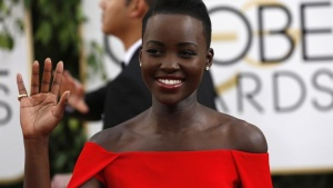 Actress Lupita Nyong'o, of the film '12 Years A Slave' waves as she arrives at the 71st annual Golden Globe Awards in Beverly Hills, California January 12, 2014. REUTERS/Mario Anzuoni/Files