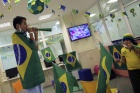 Brazilian patients Kaio (L), 13, and Luana, 10, play a horn at the end of the 2014 World Cup Group A soccer match between Brazil and Mexico at the Cancer Itaci Hospital in Sao Paulo June 17, 2014.  REUTERS/Nacho Doce