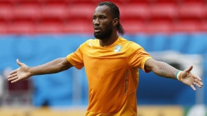 Ivory Coast's Didier Drogba reacts during a team training session at the Mane Garrincha National Stadium in Brasilia, June 18, 2014.  REUTERS/Ueslei Marcelino (BRAZIL  - Tags: SOCCER SPORT WORLD CUP)