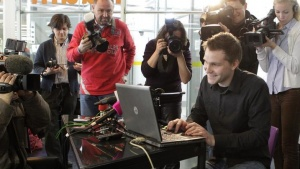 Law student Max Schrems (R) is sorrounded by journalists as he briefs the media in Vienna February 7, 2012. REUTERS/Herwig Prammer/Files