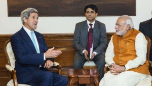 U.S. Secretary of State John Kerry (L) speaks with Prime Minister Narendra Modi (R) at the Prime Minister's residence in New Delhi August 1, 2014.  REUTERS/Lucas Jackson