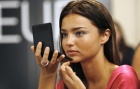 Victoria's Secret model Miranda Kerr checks her make-up backstage in preparation for the Victoria's Secret fashion show in Hollywood, California November 15, 2007. REUTERS/Mario Anzuoni